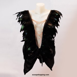 A feathered blouse with a chain on the chest